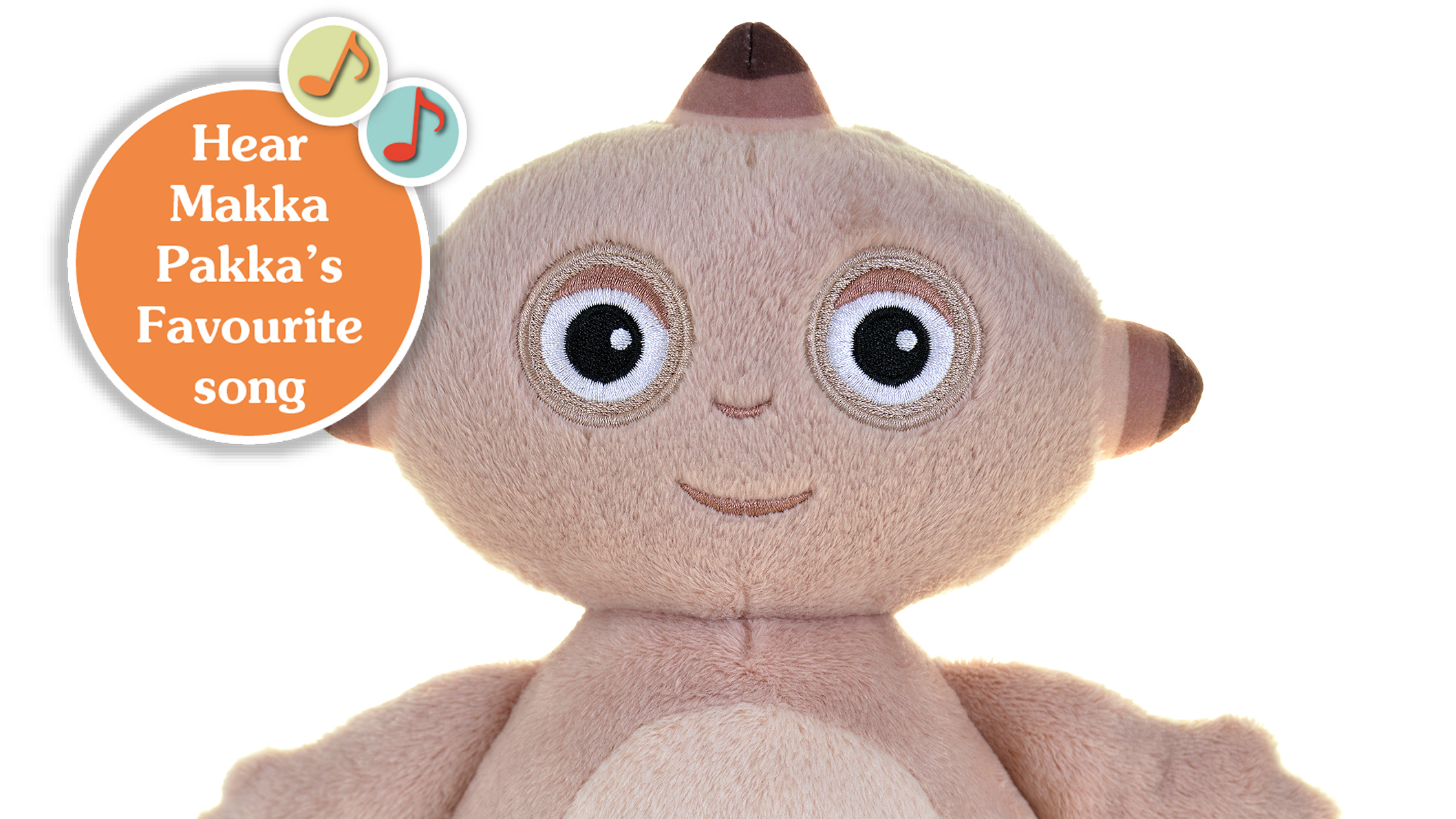 A close-up of a beige toy with an oval shaped head, in front of a white background.