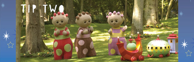 Three characters, wearing colourful costumes with polka dots, standing in a green park with a few toys on the ground.