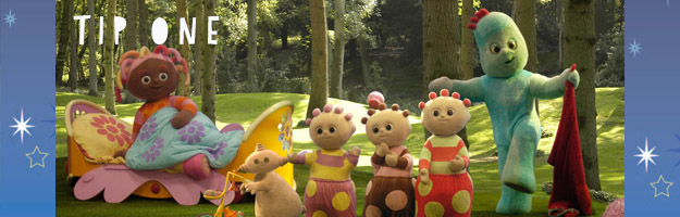 Six characters in various shapes and sizes in a park with tall trees. A female character on the left is sitting up in a bed with the rest of the characters standing in the foreground.