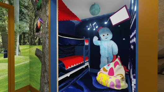 A kids' bedroom with dark blue walls and a bunk bed with red covers. There is a large illustration on the wall of a blue character holding a blanket.